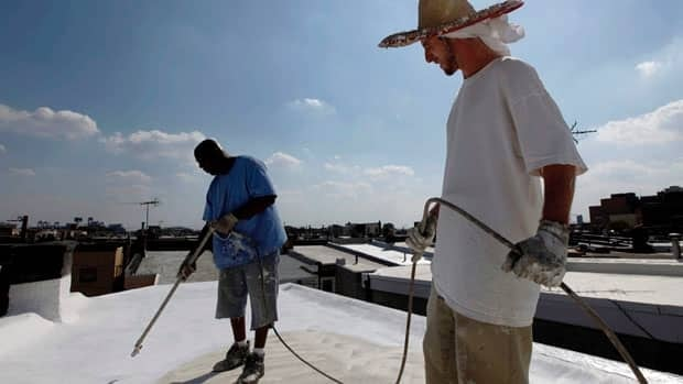 Workers in Philadelphia paint roofs white. That's one of the less extreme ways proposed to artificially cool the Earth to reverse global warming.