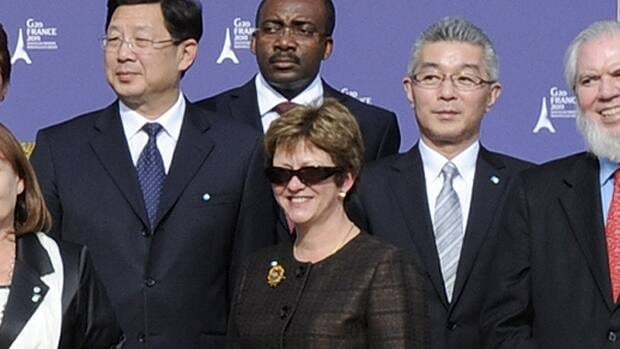 Human Resources Minister Diane Finley poses for a family picture with fellow G20 labour ministers during the G20 Labour and Employment Ministers meeting in Paris.