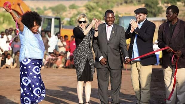Madonna, second from left, cuts the ribbon at the ground-breaking ceremony for the Raising Malawi Academy for Girls on Oct. 26, 2009. She abandoned the project in January.
