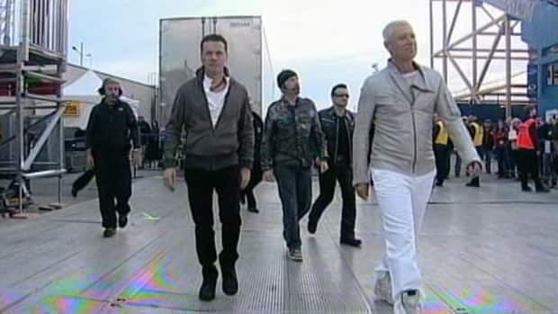 Larry Mullen Jr., The Edge, Bono and Adam Clayton make their way to the stage for the 360-degree world tour stop in Winnipeg.