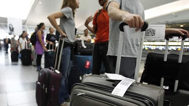 Numerous Canadian flights to and from destinations like New Yorks' John F. Kennedy airport were cancelled Sunday as Hurricane Irene set her sights on the eastern seaboard.