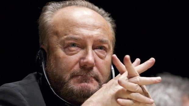 George Galloway listens to speakers during a conference Nov. 17 in Montreal. The former British MP was denied entry into Canada in 2009 partly for spurious political reasons, a court ruled.