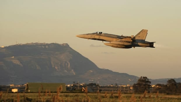 A Canadian CF-18 Hornet of the 425 Tactical squadron takes off from Trapani, Italy, on March 22, 2011, heading over the Mediterranean Sea as part of Canada's mission enforcing the UN-imposed no-fly zone in Libya.