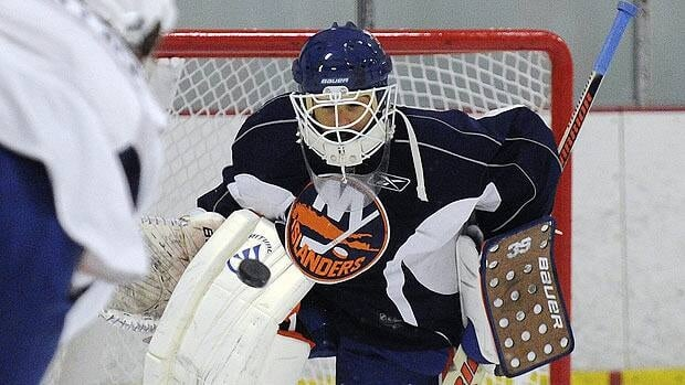 Rick DiPietro, seen during training camp, has been riddled by injuries since signing a landmark contract with the New York Islanders.