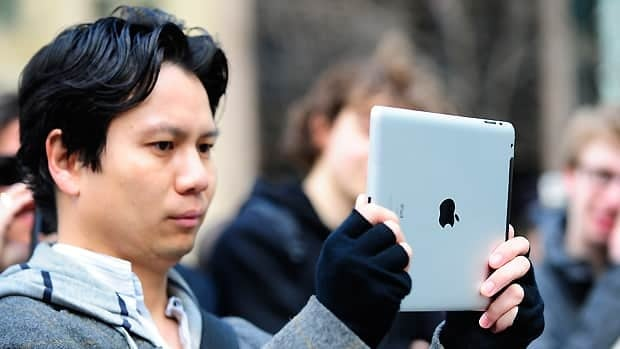 A man tests the latest iPad 2 at the Apple store on Fifth Avenue in New York. Apple's second-generation tablet will be better equipped for gaming.