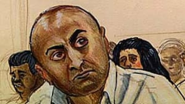 Mukhtiar Panghali listens to the prosecutor during his trial.  in which he is charged with murdering his wife.