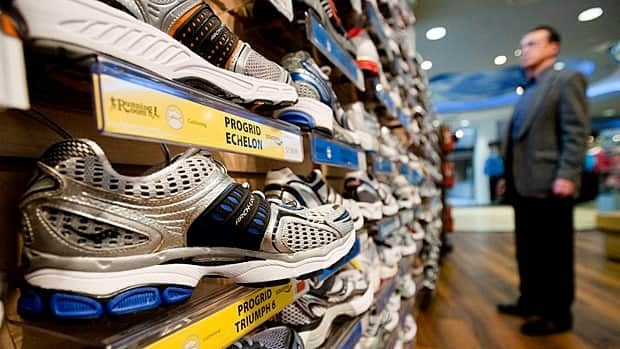 A new report says Canadians are paying about 20 per cent more than Americans for everything from running shoes to iPods despite a soaring Canadian dollar.