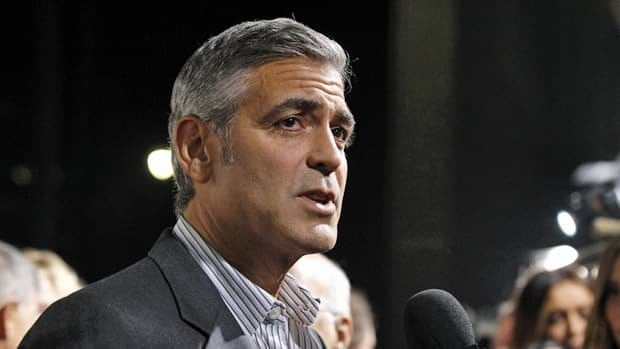 Actor George Clooney said he only met with former Italian premier Silvio Berlusconi to discuss aid for the Darfur region of Sundan and declined an invitation to attend a party.