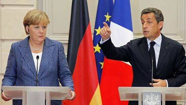 Germany's Chancellor Angela Merkel and French President Nicolas Sarkozy speak at a news conference after their meeting Tuesday.