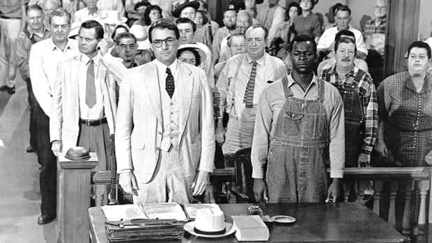 Gregory Peck, foreground left, and Brock Peters, right, in a scene from the 1962 film To Kill a Mockingbird. The novel that inspired the film is being adapted for the Broadway stage.