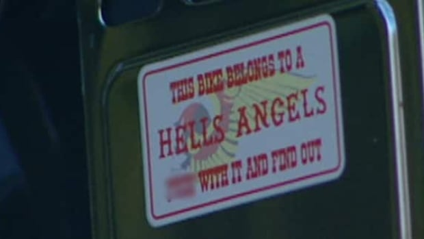 This Hells Angels sticker sits on the side of a Harley Davidson motorcycle towed by police Wednesday from a Hells Angels clubhouse in south Ottawa.