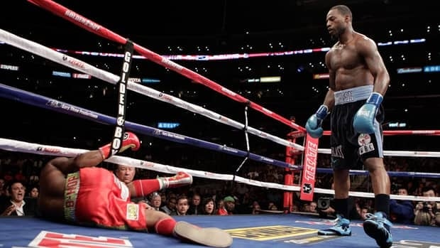 Bernard Hopkins, left, is pushed out of the ring by Chad Dawson in the second round of a light heavyweight boxing match in Los Angeles on Saturday. Dawson won by TKO in the second round after Hopkins wasn't able to continue due to his shoulder injury.