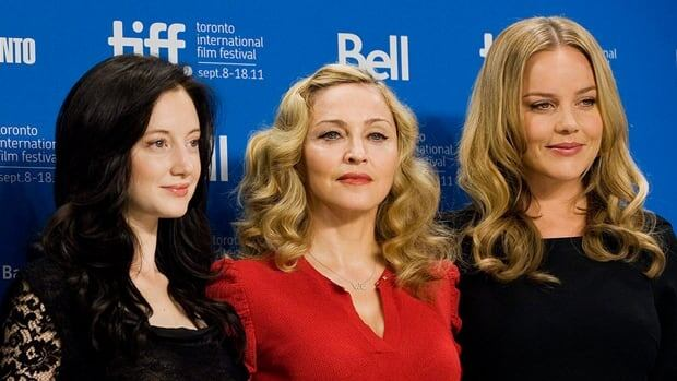 In promoting her second directorial effort, W.E., Madonna, centre, has again become a lightning rod of controversy. Here, the Material Girl is surrounded by the film's stars, Andrea Riseborough, left, and Abbie Cornish, right.