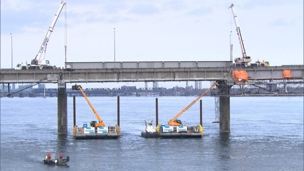 Crews work on Montreal's aging Champlain Bridge.