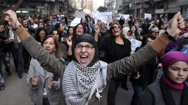 Hundreds of Egyptian women march at Cairo streets during a protest as they angered by the recent violence used against them in clashes between police and protesters in Cairo, Egypt on Tuesday, Dec. 20, 2011.
