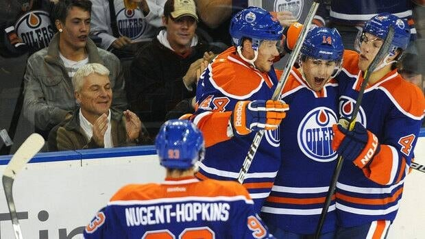 Edmonton Oilers' Jordan Eberle, second from right, celebrates his goal against the Washington Capitals with teammates Ryan Nugent-Hopkins, front, Corey Potter, left, and Taylor Hall, right, on Thursday night.