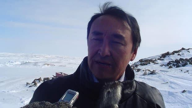 Paul Okalik, the new Liberal candidate for Nunavut, speaks at an outdoor news conference Wednesday in Iqaluit.