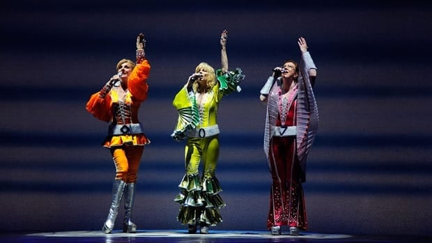 Mamma Mia actresses, from left, Judy McLane, Lisa Brescia and Jennifer Perry sing during the 4,000th Broadway performance of the hit musical in New York in May. The international success of the show helped seal the deal for a Mandarin-language version, said its Chinese partners.
