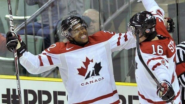 Team Canada forward Devante Smith-Pelly, left, reacts with teammate Mark Stone after scoring against Team Switzerland during third period.
