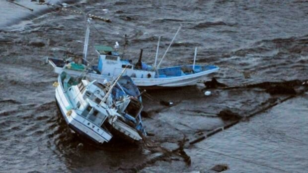 Fishing boats get stranded on shore at Oarai town, Ibaraki prefecture, Japan, after a ferocious tsunami spawned by one of the largest earthquakes ever recorded slammed Japan's eastern coasts Friday.