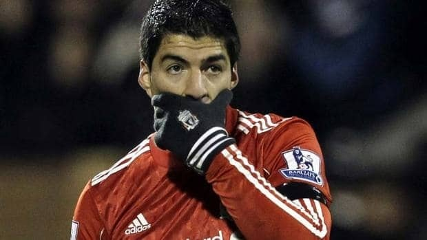 Liverpool's Luis Suarez seems to be considering a way to keep from saying something controversial, back during this Dec. 5 match against Fulham. Suarez left the pitch with one finger held high.