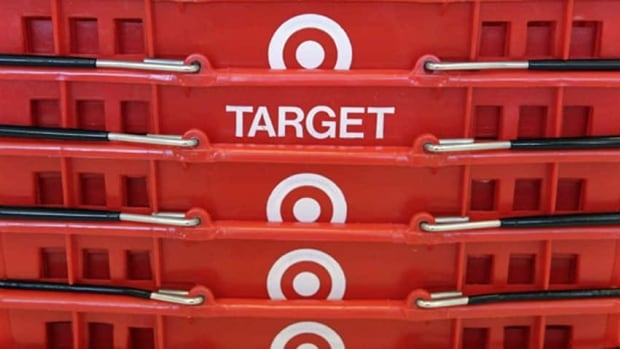 Target says it will lay off 475 people worldwide and it has cut 700 jobs over the last six months. (Associated Press)