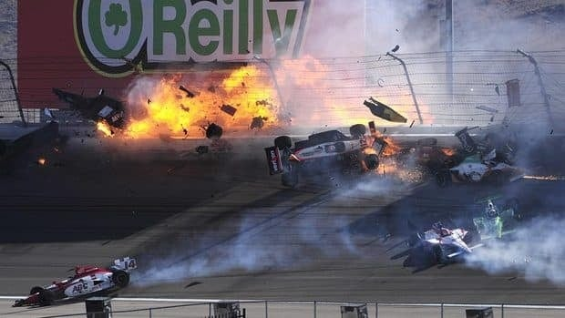 The car of Dan Wheldon, top left, bursts into flames in Sunday's 15-car pileup at the Las Vegas Motor Speedway.
