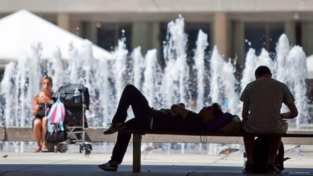 Torontonians try to stay cool during a heat wave in July 2011. A new report says climate change will bring costs to public health, including deaths due to extreme heat and air pollution.