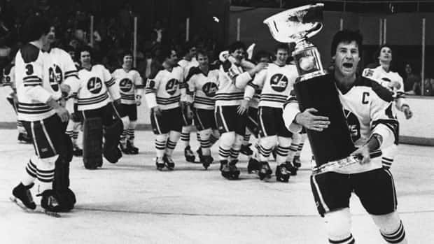 Winnipeg Jets captain Lars-Erik Sjoberg carries the Avco World Trophy after the team won the 1979 WHA championship.