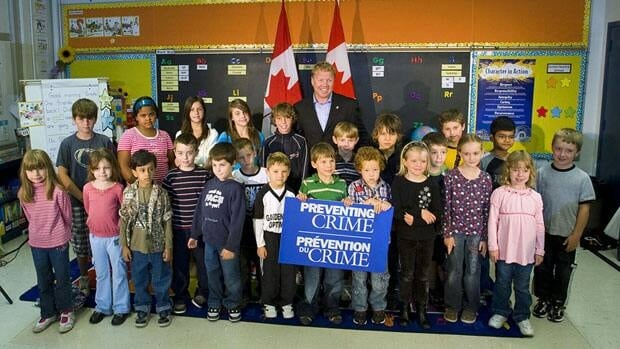 Rick Dykstra, MP for St. Catharines, Ont., seen here with school children at a September 2009 funding announcement, is stepping back after he said Wednesday the government was going to make the short-form census voluntary.