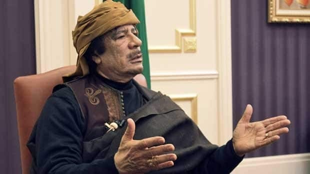 Libyan leader Moammar Gadhafi speaks during an interview with TRT Turk television reporter Mehmet Akif Ersoy at the Rixos hotel in Tripoli.