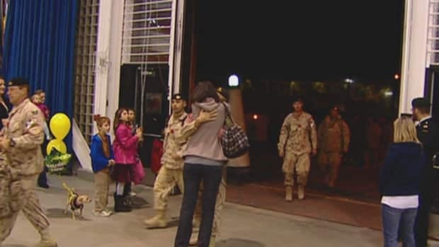 Families reunite in Petawawa, Ont., after troops return from Afghanistan. Transitioning from the field to back home is a struggle for many soldiers.