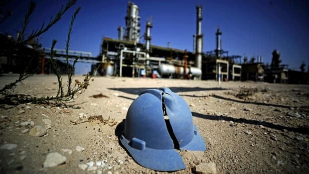 A worker's helmet lies on the ground at the Zawiya oil refinery, some 40 km west of Tripoli, on Friday after Libyan rebels pushing to cut off Tripoli took control of the facility.