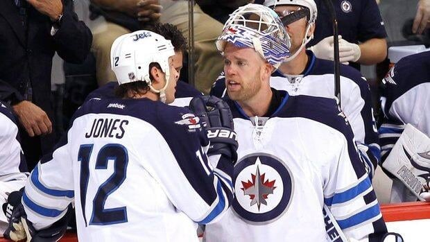 Jets goaltender Chris Mason, right, has posted a 1-2-0 record this season with a 2.68 goals-against average and .893 save percentage.