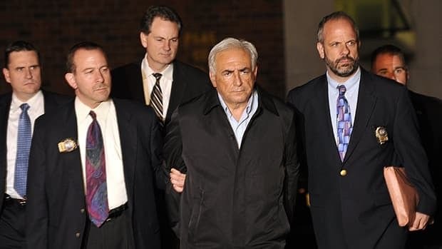 Then International Monetary Fund managing director Dominique Strauss-Kahn leaves the New York Police Department special victims unit headquarters in Harlem on May 15, 2011.
