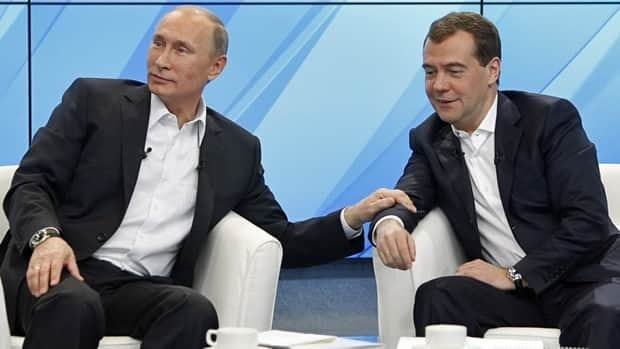 Russia's President Dmitry Medvedev(right)and Prime Minister Vladimir Putin meet their supporters in Moscow on Dec. 1, 2011. Putin has accused Western governments of trying to influence Sunday's election.