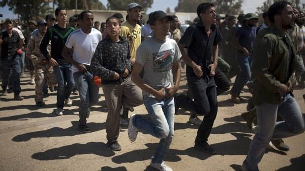 New recruits to fight against Moammar Gadhafi's troops train in Benghazi, Libya, Monday.