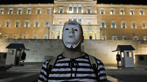 Protesters, dressed as prisoners gather during an event to protest against austerity measures outside the Greek parliament in Athens, Nov. 1.