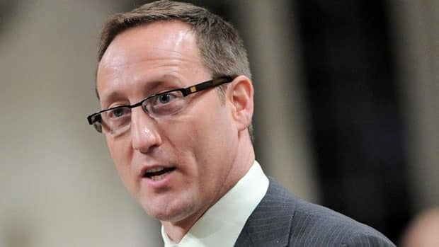 Opposition MPs are demanding Defence Minister Peter MacKay step down from cabinet after emails from defence officials show he requested use of a military chopper to save time getting to an airport in Gander, Nfld.