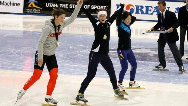Katherine Reutter, centre, of the United States, celebrates winning the women's 1,500-metre final with second place finisher Valerie Maltais, left, of Canada, and third place finisher Eun-Byul Lee, of South Korea, at the short track World Cup speedskating event at the Utah Olympic Oval on Saturday.