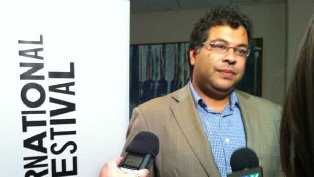 Calgary Mayor Naheed Nenshi takes questions from reporters after the Friday world premiere of @nenshi4mayor at the Calgary International Film Festival.