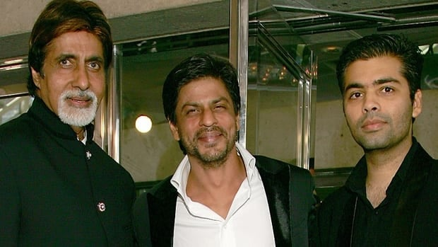 Actors Amitabh Bachchan, left, and Shahrukh Khan, centre, join director Karan Johar at the Toronto International Film Festival premiere of Never Say Goodbye in 2006.