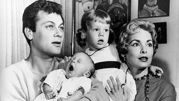 Tony Curtis and Janet Leigh are shown with their newborn daughter Jamie Lee and elder daughter Kelly in Hollywood, Calif. in 1959. An auction of memorabilia and mementos from Curtis's personal collection fetched more than $1 million US on Saturday.