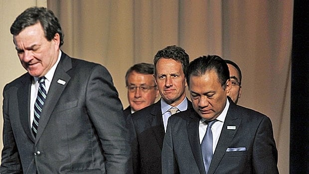 APEC finance minister including Jim Flaherty, at left, pledged to keep the European debt crisis from spreading.