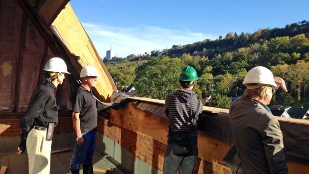 Harry Stinson, left, shows visitors the view from the south penthouse. It's yours for $700,000.