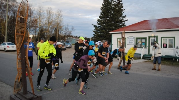 Runners cross the starting line in the 2013 Trapline Marathon, an annual 42-kilometre race from North West River to Happy Valley-Goose Bay that follows a trapping route.