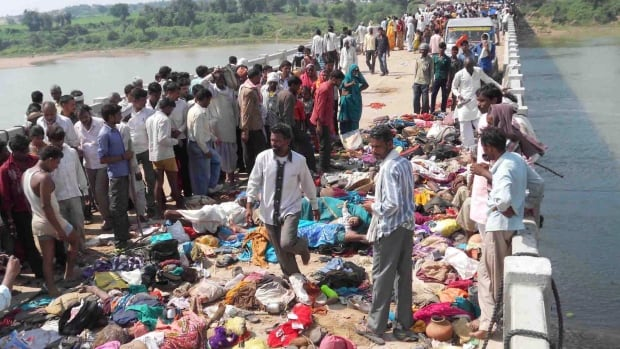 The bodies of victims of a stampede lie on a bridge across the Sindh River in Datia district in Madhya Pradesh state, India. Scores of people were killed Sunday in a stampede by masses of Hindu worshippers crossing the bridge to the remote Ratangarh village temple to honour the Hindu mother goddess Durga on the last day of the popular 10-day Navaratra festival.