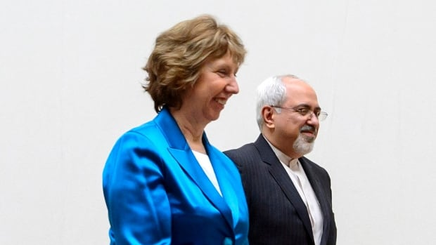 "European Union foreign policy chief Catherine Ashton, left, walks next to Iranian Foreign Minister Mohammad Javad Zarif before the start of two days of closed-door nuclear talks at the United Nations offices in Geneva Oct. 15.  Iranian media said a package of new Iranian proposals presented Tuesday was entitled ""Closing an Unnecessary Crisis, Opening New Horizons"" but did not elaborate."