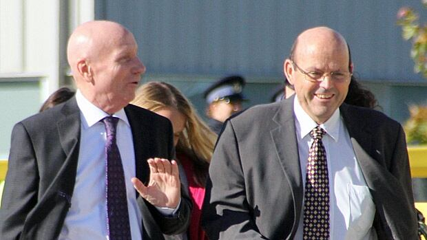 Grand River Raceway General Manager Ted Clarke (right) walks with John Snobolen (left), the head of Ontario's new horse racing regulatory agency, Ontario Live Racing. The province recently announced a five year plan, which would inject $400 million into horse-racing provincewide, starting in April.