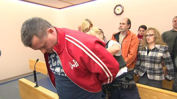 William Parker is put in cuffs in St. John's provincial court Tuesday after being sentenced to four years in prison.